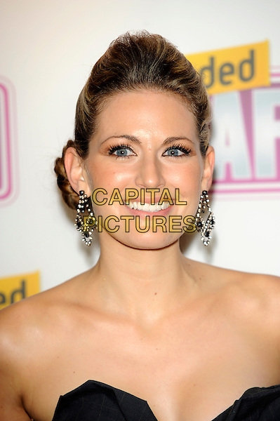OLIVIA LEE .Attending the Loaded LAFTA's Comedy Awards at the Cuckoo Club, London, England, January 27th 2010..LAFTAs arrivals portrait headshot earrings hair up smiling strapless black dangly .CAP/CJ.©Chris Joseph/Capital Pictures.