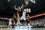 30 January 2016: Boston College's Dennis Clifford (24) blocks a shot by North Carolina's Isaiah Hicks (4). The University of North Carolina Tar Heels hosted the Boston College Eagles at the Dean E. Smith Center in Chapel Hill, North Carolina in a 2015-16 NCAA Division I Men's Basketball game. UNC won the game 89-62.