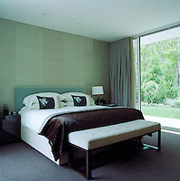 The bed and the bench in the master bedroom, which overlooks the gardens, are bespoke and designed by Shamir Shah
