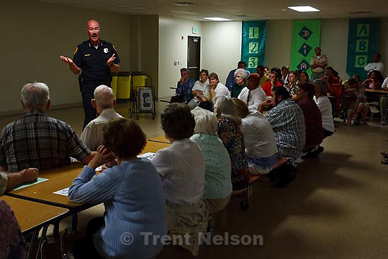 Salt Lake City - Salt Lake City Police Chief Chris Burbank took questions from residents during a meeting of the Glendale Community Council Wednesday, July 16 at the Dual Immersion Academy.