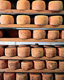 FRANCE, Saint-Point-Lac, stacks of Mont D'or cheese dry on racks at the Fromagerie Michelin, Franche-Comte region