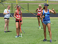 NWA Democrat-Gazette/ANDY SHUPE<br /> Stacy Dragila (right), a former Olympic pole vaulter and 2000 Olympic gold medalist, works with campers Friday, June 16, 2017, during instruction for pole vaulters at Ramay Junior High School in Fayetteville. Dragila and April Steiner Bennett, a former Arkansas and Olympic pole vaulter, were on hand for two days of intensive instruction for vaulters from elementary to high school.