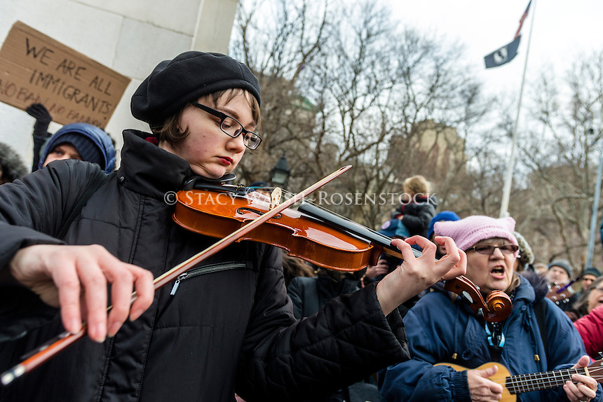 New York, USA 5 February 2017 - THIS IS WHAT DEMOCRACY SOUNDS LIKE Several hundred people gathered beneath the arch in Washington Square Park for a community sing along, playing folk songs to benefit the ACLU (American Civil Liberties Union) and NYCLU (New York Civil Liberties Union) in their lawsuits challenging president donald trump, human rights as well as civil rights issues. @ Stacy Walsh Rosenstock