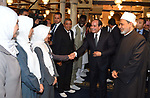 Saudi Crown Prince Mohammed bin Salman (C, front) shaking hands with male foreign students of Al-Azhar University, at the historic Azhar mosque complex, followed by President Abdel Fattah al-Sisi (C, behind) during the former's visit to the mosque, on March 6, 2018. Photo by Egyptian President Office
