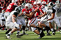 29 October 2011: Rex Burkhead #22 of the Nebraska Cornhuskers rushes around the left end against the Michigan State Spartans at Memorial Stadium in Lincoln, Nebraska.  Nebraska defeated Michigan State 24 to 3.