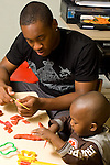 preschool 2-3 year olds high school volunteer intern art activity play dough working with boy