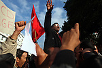 Protesters sang the Tunisian National Anthem during a demonstration in downtown Tunis, Tunisia, Jan. 19, 2011. This time the people demanded the Prime Minister, Mohamed Ghannouchi, step down. The protest this time was peaceful--the police did not use tear gas or other means of force to dissolve the demonstration.