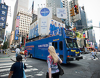 "A tour bus advertising United Airlines passes beneath advertising on billboards in Times Square in New York for the ABC television program, ""Pan Am"", seen on Tuesday, September 13, 2011.  The program is set in 1961 and follows the exploits of stewardesses for the now defunct airline. (© Richard B. Levine)"