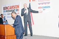 New Hampshire State Representative David Bates auctions off a poster signed by Republican presidential candidate Dr. Ben Carson after Carson spoke at a town hall campaign stop at a meeting of the Windham Republican Town Committee at the Castleton Banquet and Conference Center in Windham, New Hampshire.