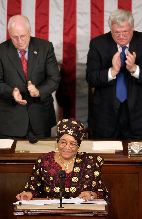 Ellen Johnson Sirleaf, president of the Republic of Liberia, addresses a joint session of Congress in House Chamber.  Vice President Dick Cheney, left, and Speaker of the House Dennis Hastert, R-Ill., attended the session.