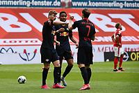 24th May 2020, Opel Arena, Mainz, Rhineland-Palatinate, Germany; Bundesliga football; Mainz 05 versus RB Leipzig; Yussuf Poulsen (RB Leipzig), Christopher Nkunku (RB Leipzig), Marcel Sabitzer (RB Leipzig) celebrate the goal for 0:3