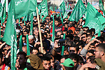 Palestinians attend a military parade of members of al-Qassam Brigades, the armed wing of the Hamas movement, to mark the 28th anniversary of the Islamist movements creation on December 11, 2015, in the Jabalia refugee camp, in northern Gaza. Photo by Mohammed Asad