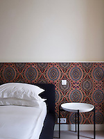 Patterned wallpaper by Eley Kishimoto in one of the guest bedrooms
