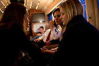 Daughters Arianna (right) and Ayla speak with their mother's aide Kristen Granchelli (left) on Senator Scott Brown's (R-MA) campaign bus between campaign stops in North Billerica and Wakefield, Massachusetts, USA, on Thurs., Nov. 2, 2012. Senator Scott Brown is seeking re-election to the Senate.  His opponent is Elizabeth Warren, a democrat.