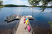 Eagle Bay, New York. Big Moose Lake. The Waldheim (vacation resort in the style of the traditional Adirondack great camps). View of the main dock, (including canoes, kayaks, and boats) and the lake. ID: AJ-DC. © Ellen B. Senisi