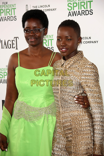 SANTA MONICA, CA - March 01: Lupita Nyong'o and mother at the 2014 Film Independent Spirit Awards Arrivals, Santa Monica Beach, Santa Monica,  March 01, 2014. Credit: Janice Ogata/MediaPunch<br /> CAP/MPI/JO<br /> &copy;JO/MPI/Capital Pictures