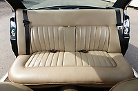 BNPS.co.uk (01202 558833)<br /> Pic: RMSotheby's/BNPS<br /> <br /> Special leather bench seat for the Corgi's...<br /> <br /> The Queens personal Daimler - fitted with special rear seats for her Corgi's comfort - has sold for £80,500 at auction.<br /> <br /> The Daimler Double Six was delivered new to Buckingham Palace in 1984 for the personal use of the monarch, then aged 58.<br /> <br /> Prior to her taking ownership of the green four door it was given a 3,000 mile road test by factory engineers to ensure it was perfect upon delivery.