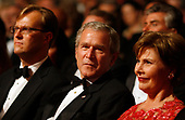 United States President George W. Bush and First Lady Laura Bush at the annual Ford's Theatre Gala in Washington, DC, which is being taped now for a Christmastime airing on June 24, 2007. At left is Paul Tetreault, Ford's Theatre Producing Director. <br /> Credit: Chris Maddaloni / Pool via CNP