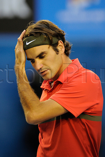 26.01.2012 Australian Open Tennis from Melbourne Park. Roger Federer (SUI) brushes away hair during his match on the eleventh day of the Australian Open Tennis Championships in Melbourne, Australia.