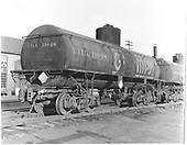 3/4 view of GRAMPS UTLX 11048 tank car at Alamosa.<br /> D&amp;RGW  Alamosa, CO  Taken by Polkinghorn, R. S. - 8/1964