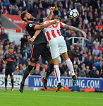 Olivier Giroud of Arsenal is challenged by Geoff Cameron of Stoke City during the premier league match at the Britannia Stadium, Stoke. Picture date 19th August 2017. Picture credit should read: Robin Parker/Sportimage