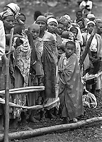 Rwandans wait in line for treatment at the AmeriCares (CQ) clinic in Buranga, Rwanda in 1994. The clinic saw between 200 and 350 people per day with a myriad of health problems resulting from a collapsed infrastructure resulting from civil war. The clinic served people who would walk as many as four hours to reach the location as well as a trickle of refugees returning from the camps in Goma, Zaire (now Congo). The Connecticut relief organization ran the clinic in the fall of 1994. (Photo Rick D'Elia)