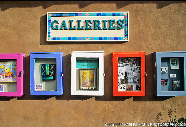 Colorful signs indicate galleries to come on Gypsy Alley on Canyon Road in Santa Fe.