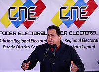 Venezuelan Hugo Chavez  casts his vote in 23 de Enero, a humble district of Caracas