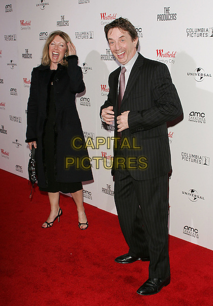 "MARTIN SHORT & GUEST.""The Producers"" World Premiere held at the Westfield Century City, Century City, California..December 12th, 2005 .Photo: William Scott/ AdMedia/Capital Pictures.Ref: WS/ADM.full length black suit laughing pinstripe.www.capitalpictures.com.sales@capitalpictures.com.© Capital Pictures."