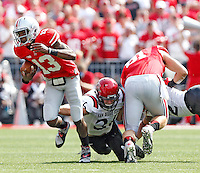 Ohio State Buckeyes quarterback Kenny Guiton (13) gets past San Diego State Aztecs linebacker Nick Tenhaeff (36) during a rush during the 1st quarter of their college football game at Ohio Stadium in Columbus on September 7, 2013.  (Dispatch photo by Kyle Robertson)