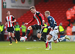 Lee Evans of Sheffield Utd leaps up to control the ball during the championship match at the Bramall Lane Stadium, Sheffield. Picture date 14th April 2018. Picture credit should read: Simon Bellis/Sportimage