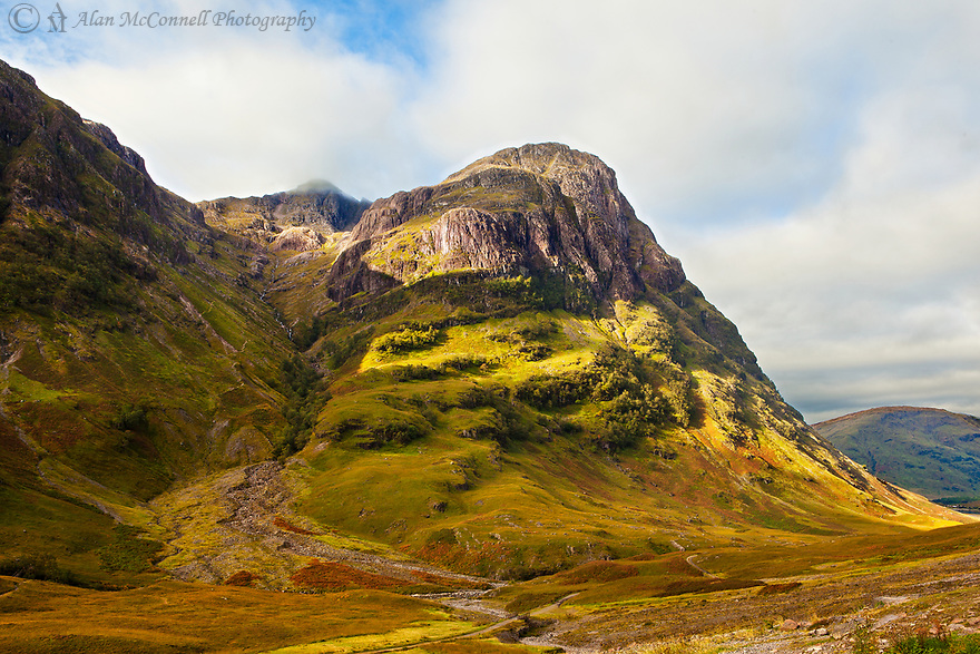 Aonach Dubh of the Three Sisters stands prominently in the late afternoon sun in the Scottish Highlands of Glencoe.
