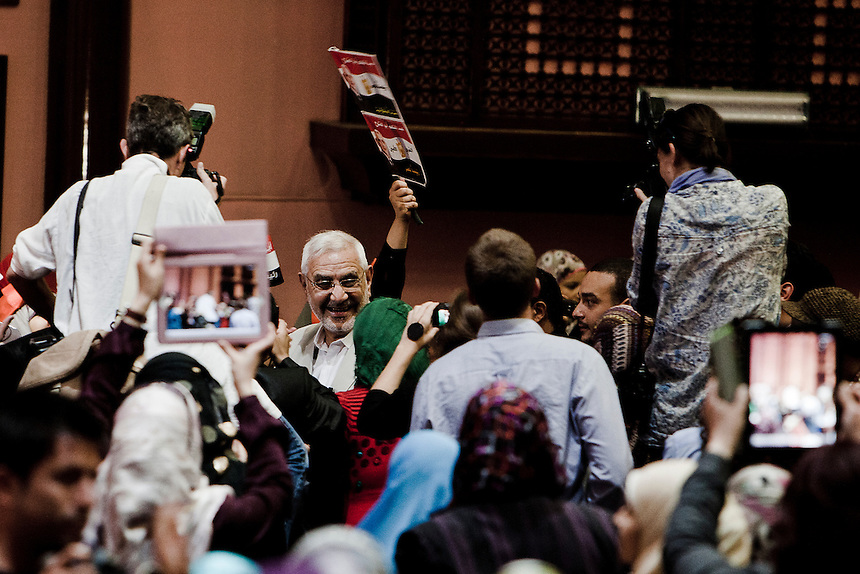 Progressive presidential candidate, and former senior Muslim Brotherhood member, Dr Abdel Mouneim Aboul Fotouh, moves through a crowd of supporters at a campaign event in Cairo, May 15, 2012. Photo: ED GILES.