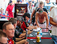 Sep 1, 2018; Clermont, IN, USA; NHRA funny car driver Cruz Pedregon signs autographs for a fan during qualifying for the US Nationals at Lucas Oil Raceway. Mandatory Credit: Mark J. Rebilas-USA TODAY Sports
