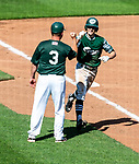 HARTFORD, CT-062520JS09—Great Falls Gators' Caleb Shpur is congratulated by associate head coach Ryan McDonals (3) after hitting a solo home run in the fourth inning in their game against the Terryville Black Sox Thursday at Dunkin Donuts Park in Hartford. <br /> Jim Shannon Republican-American
