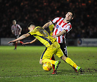 Lincoln City's Tom Pett vies for possession with Cheltenham Town's Ilias Chatzitheodoridis<br /> <br /> Photographer Andrew Vaughan/CameraSport<br /> <br /> The EFL Sky Bet League Two - Cambridge United v Lincoln City - Friday 9th February 2018 - Abbey Stadium - Cambridge<br /> <br /> World Copyright &copy; 2018 CameraSport. All rights reserved. 43 Linden Ave. Countesthorpe. Leicester. England. LE8 5PG - Tel: +44 (0) 116 277 4147 - admin@camerasport.com - www.camerasport.com