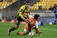 Wellington Phoenix&rsquo; Andrija Kaluderovic and Brisbane&rsquo;s Retros Skapetis in action during the A League - Wellington Phoenix v Brisbane Roar FC at Westpac Stadium, Wellington, New Zealand on Saturday 28 October.<br /> Photo by Masanori Udagawa. <br /> www.photowellington.photoshelter.com
