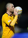 Hat-trick scorer Michael Higdon hisses the match ball after the game