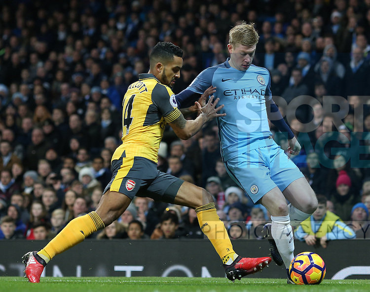 Theo Walcott of Arsenal challenges Kevin De Bruyne of Manchester City during the English Premier League match at the Etihad Stadium, Manchester. Picture date: December 18th, 2016. Picture credit should read: Simon Bellis/Sportimage