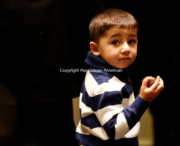 Southbury, CT- 01 February 2015-020115CM07-  Country life only please---- Azaan Noori, 2, of Waterbury enjoys a chocolate treat during the Easter Seals Chocolate Expo at the Southbury Crowne Plaza Hotel on Sunday.   Christopher Massa Republican-American