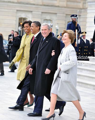 Washington, DC - January 20, 2009 -- First lady Michelle Obama, United States President Barack Obama, former United States President George W. Bush, East Front of the United States Capitol in Washington, D.C. on Tuesday, January 20, 2009..Credit: Ron Sachs - Pool via CNP
