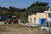 Pictured: The house where Ben Needham disappeared from in Kos, Greece. Thursday 29 September 2016<br /> Re: Police teams searching for missing toddler Ben Needham on the Greek island of Kos have said they are &quot;optimistic&quot; about new excavation work.<br /> Ben, from Sheffield, was 21 months old when he disappeared on 24 July 1991 during a family holiday.<br /> Digging has begun at a new site after a fresh line of inquiry suggested he could have been crushed by a digger.<br /> South Yorkshire Police (SYP) said it continued to keep an &quot;open mind&quot; about what happened to Ben.