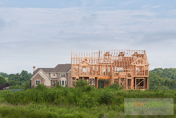New Residential Wood Frame House being built next to an existing Mansion