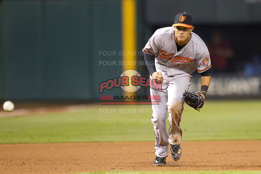 Baltimore Orioles third baseman Manny Machado #13 fields a grounder during the Major League Baseball game against the Texas Rangers on August 21st, 2012 at the Rangers Ballpark in Arlington, Texas. The Orioles defeated the Rangers 5-3. (Andrew Woolley/Four Seam Images).
