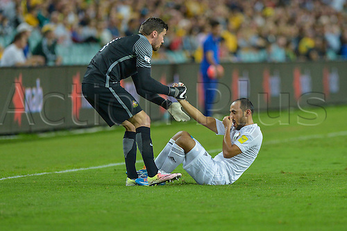 29.03.2016. Allianz Stadium, Sydney, Australia. Football 2018 World Cup Qualification match Australia versus Jordan.  Australian goalkeeper Mathew Ryan helps up Jordan midfielder Munther Abu Amarah after a heavy tackle. Australia won 5-1.
