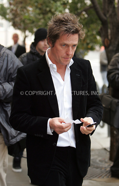 WWW.ACEPIXS.COM . . . . . ....November 13 2007, New York City....Hugh Grant leaving the memorial service for show biz publicist Robert Garlock at the Walter Reade Theatre in the Lincoln Center in midtown Manhattan.....Please byline: DAVID MURPHY - ACEPIXS.COM.. . . . . . ..Ace Pictures, Inc:  ..(646) 769 0430..e-mail: info@acepixs.com..web: http://www.acepixs.com