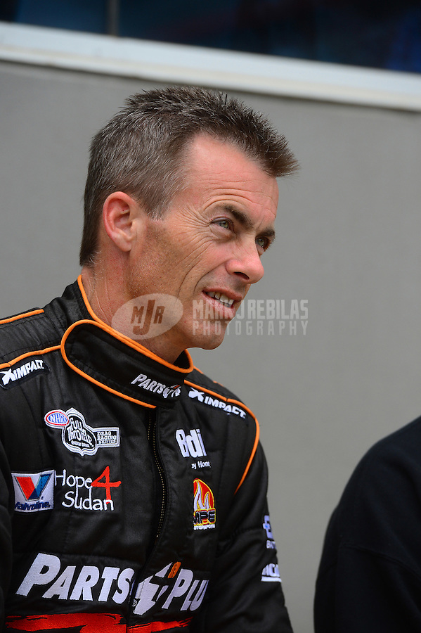 Apr. 15, 2012; Concord, NC, USA: NHRA top fuel dragster driver Clay Millican during eliminations for the Four Wide Nationals at zMax Dragway. Mandatory Credit: Mark J. Rebilas-