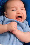 2 month old baby boy closeup crying unhappy