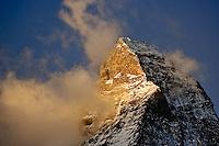 Clouds around the summit of the Matterhorn at sunrise, Zermatt, Switzerland