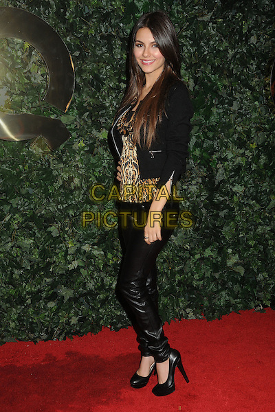 VICTORIA JUSTICE.QVC Red Carpet Style Party held at the Four Seasons Hotel, Beverly Hills, California, USA..February 25th, 2011.full length black leather trousers jacket brown beige leopard print top side.CAP/ADM/BP.©Byron Purvis/AdMedia/Capital Pictures.